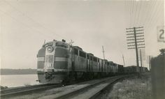 ATSF #101 - EMD FT - commands a manifest freight at Ft. Madison, IA in 1946. Photo by Otto C. Perry.
