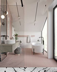 pink bathroom with black and white marbled tiles