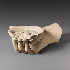 Limestone hand holding a phiale (libation bowl)  Period:     Classical Date:     5th–4th century B.C. Culture:     Cypriot