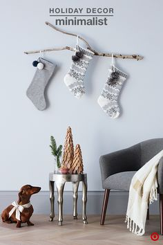 Bringing the outdoors in can create a beautifully minimalistic look during the holidays. A tree branch is a fun and festive way to hang Christmas stockings, while giving walls a natural, holiday feel. Accent your space with this unique Threshold deer leg accent table topped with wooden trees and other holiday décor. Add a comfy chair and cozy blanket for the perfect place to relax.