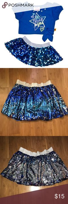 Justice blue sequin skirt Worn once. Great quality justice blue sequin skirt. Extremely beautiful and shiny skirt. Has navy blue shorts under. The sequins are also reversible so the skirt shows more of a silver look rather than the blue look. Has beautiful silver elastic waistband. Perfect for special occasions or everyday wear! Comment below any questions or measurement requests. 💜MAKE AN OFFER💜 Justice Bottoms Skirts