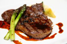 Grilled ribeye steak, garlic tomatoes, shallot confit in red wine sauce