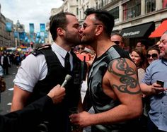 A policeman (left) kisses his boyfriend after proposing to him during the Pride in London parade, as it makes its way through the streets of central, London. Picture: Daniel Leal-Olivas/PA Wire