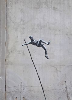 JO : Banksy street-art artist plays with olympics symboles