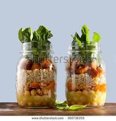 """hot Salad from roasted Pumpkin, Chickpeas, carrots, quinoa, and spinach in Mason jars . Healthy Lunch """"to go"""" in glass jar"""
