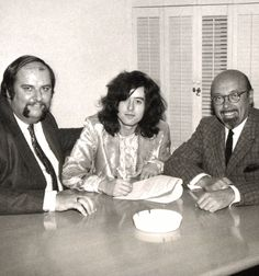Jimmy Page flanked by manager Peter Grant and Atlantic Records owner Ahmet Ertegün - signing Led Zeppelin in 1968
