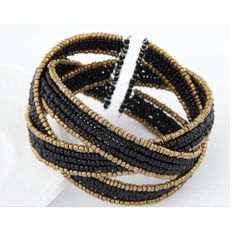 ☘2/$20•3/$27 Black/ gold cuff bracelet Black/ gold beaded cuff bracelet. Brand new without tags. This has a little bit of stretch so it can be worn on many sizes of wrists. This has some weight to it. PLEASE do not purchase this listing. Price is firm unless bundled. No tradesAVAILABILITY- 1 Boutiq Jewelry Bracelets