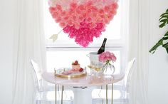 DIY this hanging faux flower heart to set the mood for your romantic at-home dinner date.