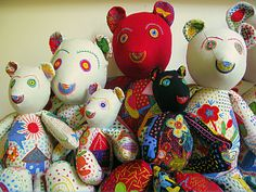 Teddy bears and linens colorfully hand-embroidered by a women's club in South Africa