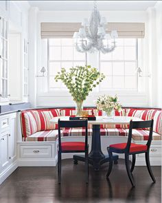 breakfast nook with curved window seat with striped cushions