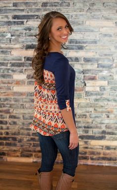 Front view navy knit top w/ Aztec accent pocket