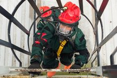 Air Force Staff Sgt. Ivon Palacios-Araujo climbs a ladder to access a tower holding a simulated patient during a pre-external evaluation exercise at Pelham Range, Ala., April 19, 2016. Palacios-Araujo is a search and extraction medic with the Georgia Air National Guard's Detachment 1, 116th Medical Group. Georgia National Guard photo by Air Force Senior Master Sgt. Roger Parsons