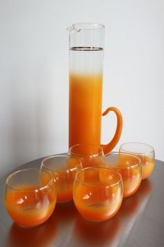 Orange Frosted Glass Blendo Set - Drink serving pitcher with 6 matching roly poly glasses, Orange frost color. Gold rims on glasses and band on