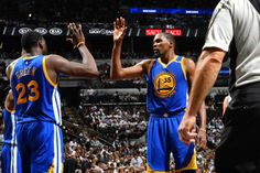 Kevin Durant and Draymond Green of the Golden State Warriors high five each other during the game against the San Antonio Spurs during Game Three of...