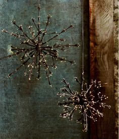 Lighted twig snowflakes - so cute and a great idea. Dare I say DIY is a possibility.