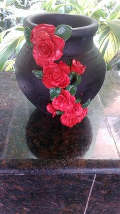 Clay roses on flower pot