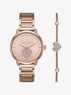 Michael Kors Portia Pave Rose Gold-Tone Watch Finished In Radiant Rose Gold-Tone Plating The Portia Watch Features A Unique Heart-Shaped Sub-Eye Thats Studded With Pave Crystals. The Classic Mid-Size Style And Bracelet Strap Offer Effortless Versatility For Everyday Wear. $295 #Michaelkorswatchforwomen