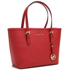 NWT-Fall Michael Kors Jetset handbag NWT MK Jet Set Travel handbag.  Chili red.  Great for the fall season.  Price is firm. Sorry NO trades. Originally purchased from Macy's Michael Kors Bags Shoulder Bags