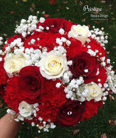 Bridal Bouquet designed using Red Roses, White Roses, Carnations & Baby's Breath http://pristinefloraldesign.com/ https://www.facebook.com/PristineFloralDesign