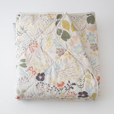 Inspired by a long meander through a woodland meadow, Austin-based artist Leah Duncan captures the flora and fauna of the natural world in this playful print. Rendered in rich but softly muted tones, this reinterpretation of vintage toile offers an artfully organic update to the bedroom. Crafted from 200-thread count percale cotton, the tightly woven fibers offer long-lasting durability with a soft, luxurious feel. Constructed with a soft but solid polyfiber fill, the quilt is hand-finished…