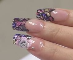 Stained glass esque, crushed sea shell gel nails, with 3D flower accent nail.