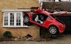 An Audi TT was left embedded in the living room of a house after an early morning accident. The driver, in his 20's, survived but has serious head injuries.  The accident occurred at 1.45am.