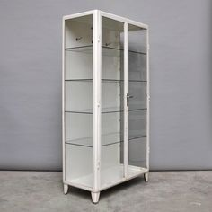 Vintage Medical Cabinet, 1950s | From a unique collection of antique and modern vitrines at https://www.1stdibs.com/furniture/storage-case-pieces/vitrines/