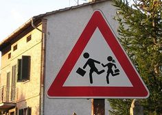 Man wearing short pants, and carrying briefcase, kidnapping schoolgirl? | Umbertide, Italy | Photo by Jeff Fisher