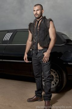Handmade leather vest with alpaca fringe and edging and crushed velvet interior. For a rugged rich yet refined look for a bold man.