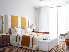 A bold, bright guest bedroom is decorated in white and tones of orange. Strong geometric patterns give the room a retro feel. White Bedroom Furniture, Bed Furniture, Home Bedroom, Furniture Design, Bedroom Decor, Bedroom Interiors, Bedroom Photography, Modern Interior, Interior Design