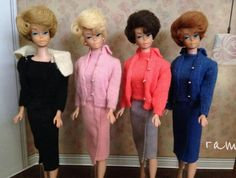 """4 bubblecut Barbies looking cozy in knits! Sweater pak, pink and blue """"Sweater Girl"""" and """"Knitting Pretty."""" From the collection of Rosalie A. McFarlane."""