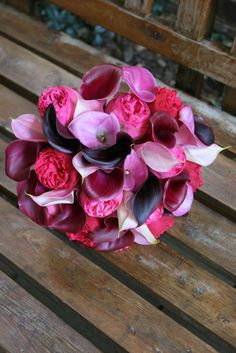 Pink calla lilies and garden roses with purple calla accents
