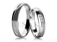 4626 Elegantní snubní prsteny z bílého zlata, jejichž středem je diagonálně vedena drážka, která rozděluje matnou (saténový mat) a lesklou část. Celkový design je velmi jemný. Dámský prsten je zdoben kameny, které jsou zasazeny těsně vedle sebe a tvoří tak příjemný celek. #bisaku #wedding #rings #engagement #svatba #snubni  #prsteny