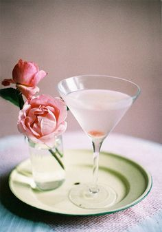 Rose Martini  {ingredients}  1 1/2 oz. vodka  1 oz. white crème de cacao  1/4 oz. rosewater  small pieces of turkish delight or rose petals to garnish  1 drop rose food color    1. fill half of a cocktail shaker with ice  2. add liquids  3. shake  4. pour  5. garnish