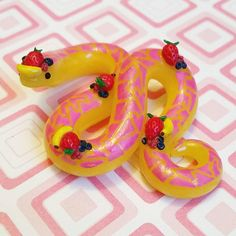 Tropical Fruit Smoothie Themed Pink and Yellow Snake. Crafted from Polymer Clay by The Clay Kiosk on Etsy.