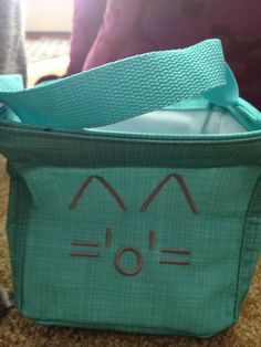 Create a cat on any 31 bag with 2 lines! Choose font style 19 /\ (one space) /\ second line (no spaces) nose is a lowercase o ='o'=. Shown here on a Turquoise Littles Carry-All Caddy.