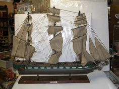 "This is a very unique antique model ship titled ""The President."""