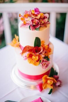 Deck out your tropical wedding cake with orchids for a fab floral dessert.