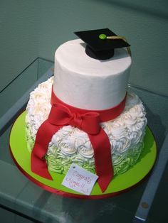 rosette grad cake - ombre rosettes in IMBC with GP cap and fondant ribbon