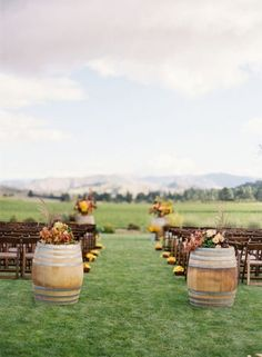 Outdoor wedding decor idea with vintage barrels and pretty marigolds at the end of each row during your wedding ceremony in the middle of a lush green field Perfect Wedding, Fall Wedding, Wedding Ceremony, Our Wedding, Dream Wedding, Outdoor Ceremony, Outdoor Weddings, Wedding Stuff, Country Weddings