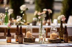 Adorable DIY rustic wedding...total cost of table centerpieces including flowers for 18 tables = $375!