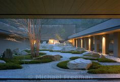 The crematorium at Hofu, Shunmyo Masuno, has created a contemplative spiritual garden seen by mourners after cremation, he created a metaphor for acceptance of mortality by symbolizing the 49-day process of becoming Buddha after death. The large main garden at the entrance symbolizes aspects of the departure from this life. The inorganic area at the back represents the afterlife with its far mountain