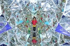 "Artists Construct Giant Kaleidoscope Inside Japanese Shipping Container - Designers Masakazu Shirane and Saya Miyazaki constructed a life-sized mirrored polyhedron installation. Entitled ""Wink,"" the piece, which premiered at Kobe Biennale's Art Container Contest, is now the third prototype based on their novel idea"