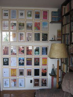 All your favorite book covers framed and hanging in the library.