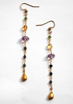 14k Gold filled Long Earrings with Amethyst, Tanzinite and Citrine Gemstones. $36.00, via Etsy.