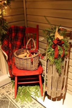 Like this for January: like the bird on the greens tied to the sled, and the chair with the plaid throw and basket of pine cones.