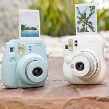 Instax Mini Instant Cameras.  This would be so fun with the kids and their friends.  I would love this.  Blue.  :)