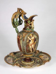 "1862 British Ewer at the Victoria and Albert Museum, London - From the curators' comments: ""Originally intended for hand-washing before a meal, by Renaissance times ewer and basins were display pieces indicative of wealth and status. Their form is here revived to demonstrate Minton's excellence of design and command of the new 'majolica' glazes."""