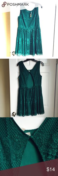 Green back peekaboo lace dress Back has one button and has a peekaboo section.. Dark green lace..51% cotton, 49% nylon... Lining : 95% polyester and 5% spandex.. Comes 1/2 above my knee.. Am 5'3 Forever 21 Dresses Midi