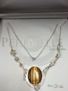 Esta gargantilla fue encargo de una clienta para su mamá, hecha con arcilla de plata 999, cabujón de ojo de tigre, Cz amarillas, cadena de plata 925